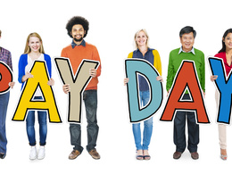 People Holding Pay Day Sign